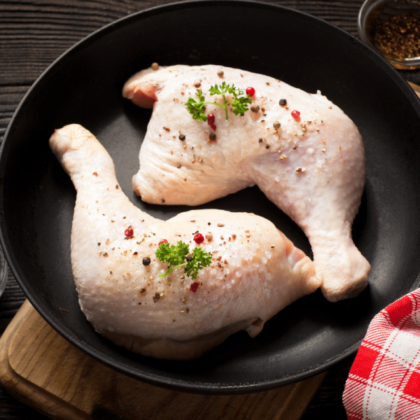 stapletons meat raw chicken thigh in a pan with herbs