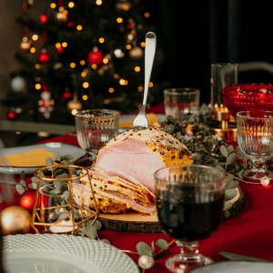 Ham with carving fork and christmas tree