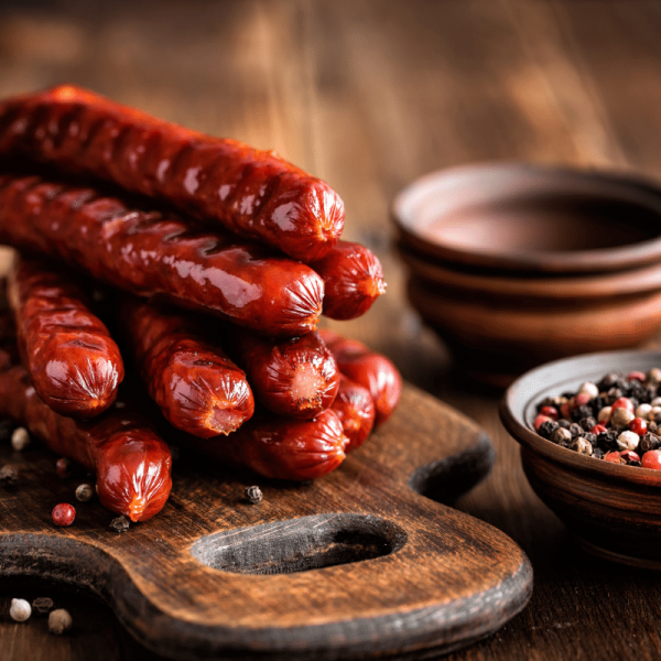 sausages on a bread board